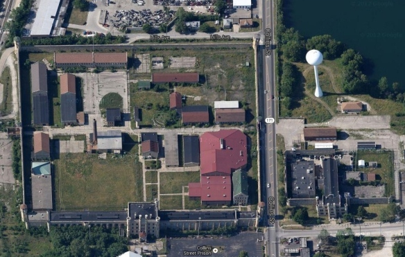 Aerial view of Collins Street Prison in Joliet, IL; the warehouse that caught fire is located halfway up and near the eastern wall, just inside the property.