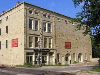 The Norton Building in Lockport, IL, a classic Joliet limestone warehouse, now serves as a gallery space for the Illinois State Museum.