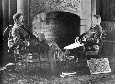 This cropped image is taken from a famous photograph of Burnham (L) and Root (R), posed in front of the inglenook in their library and conference room, that was shot for an issue of Inland Architect, a long-defunct architectural journal that was once based in Chicago.  A print of it hangs in the corridor outside the library in the Burnham & Root offices, and another copy is visible on the Rookery Building management's website.  The full image can be seen on page 70 of the Thomas S. Hines biography Burnham of Chicago: Architect and Planner.