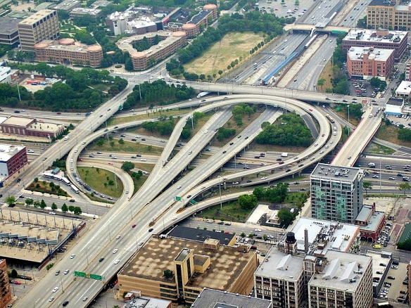 Aerial shot of Chicago's Circle Interchange, aka the ';spaghetti bowl,' looking SW; the original Vienna Sausage shop would have been in the upper right of this photo next to a four-way intersection, in teh parking lot of a building with the corner cut off stands today.  (photo courtesy of Wikimedia Commons)