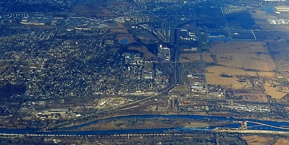 Detailed view of Lockport-Crest Hill-Joliet area looking west, with the Sanitary & Ship Canal and Des Plaines River along bottom of photo  (photo copyright 2015 by K. Yearman; all rights reserved)